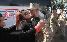 That's joy: 31 United States Marine Corp reservists of the 6th Motor Transport Battalion return from their deployment in Afghanistan back to the Marine Reserve Center in New Haven Saturday morning 4/14/12 to family, friends, well-wishers and fellow Marines waiting to greet them. the 6th Motor Transport Battalion is a reserve battalion under the command of the 4th Marine Logistics Group. Photograph by Peter Hvizdak / New Haven Register