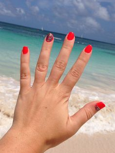 Holiday nails- Antigua 2013. Bright pink and multi coloured glitter accent nail
