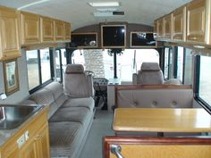 RV, Bus, upper cabinet, couch, dinette, over seat tv.