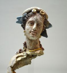 Archaeological Museum of Chania: Teracotta figurine of a woman, which preserves its bright colors and gold-plated jewelry. It was found in the ancient graveyards of Kydonia (present Chania). Early Hellenistic period.
