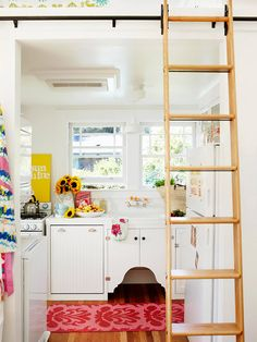 I love the sink and it's adorable cabinet!!  Quintessential Kitchen