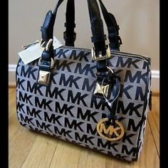 Michael Kors Grayson MD Satchel A roomy satchel that's great for every day use. Michael Kors Bags Satchels