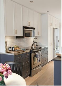 Loving the new two tone kitchen trend....