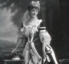 a close up of Janet Lucretia, 15th Countess of Eglington, nee Cuninghame, wearing a diamond tiara with several sunburst motifs and pearl spacers