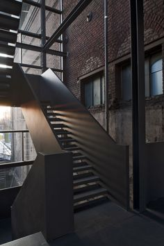 Steam Blower House by Heinrich Böll Architect.  This old industrial building has been converted into a stage storage and support facility to the performance space next door in an old industrial hall.