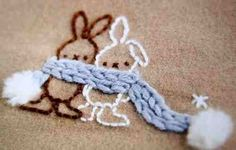 Two bunnies and a scarf . Super cute embroidery :)
