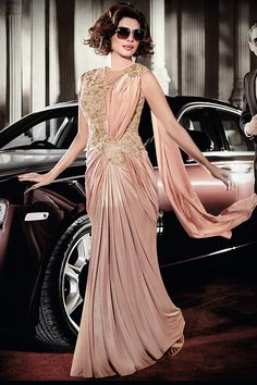 Buy Priyanka Chopra peach color lycra saree style gown in USA,UK and CANADA Party Wear Gowns Online, Gown Dress Online, Dresses Online, Drape Sarees, Drape Gowns, Designer Gowns, Indian Designer Wear, Indian Dresses, Indian Outfits