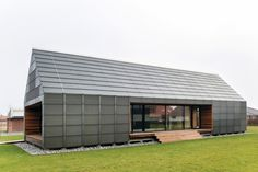 Glass-encased Maintenance-Free House is built to last - There's a small gap between the plywood shell and its glass shield (Photo: Jesper Ray) Building Costs, Modern Shed, Long House, Barn Renovation, Rural House, Glass Facades, Shed Homes, Green Architecture, Glass House