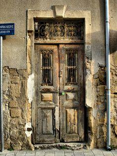 Old door, Nicosia. Of all the doors in all the world. other than my own very ordinary front door! Cool Doors, Unique Doors, Old Windows, Windows And Doors, Door Knockers, Door Knobs, Les Doors, When One Door Closes, Vintage Doors
