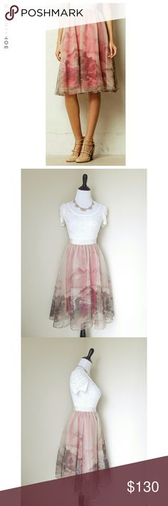 """{anthropologie} snowrose skirt This stunning skirt has 3 layers- a hot pink slip, a layer of tulle for the perfect amount of poofiness, & a gorgeous overlay w/ a train print. This skirt will make you feel like a ballerina princess.  Perfect for parties paired with a white lace top and nude heels, or wear with a black top and heels.  So unique & pretty. Sure to draw you many compliments.  From Anthropologie- Moulinette Soeurs.  Gently worn. Size 0. Waist~26"""", length~28""""  Modeled on my…"""