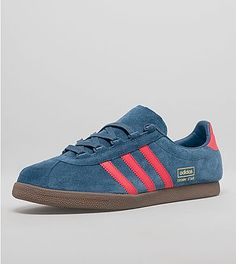 Trimm Star - First released in 1985, adidas Originals present this size? UK exclusive Trimm Star. The shoe features a sleek low profile design, 'Ghilly Lacing System' and construction of premium materials presented in a university blue suede upper with red leather three stripe branding to the side plus a red leather heel panel. The shoes are finished with tonal laces, gold Trimm Star branding to the side,thinly padded tongue plus a dark gum textured midsole.