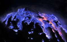 CLOSE-UP OF FLAMING MOLTEN SULFUR   Photograph by Olivier Grunewald     In this amazing close-up by Olivier Grunewald, we see molten sulfur burning atop a solid sulfur deposit. The picture was taken at the sulfur mine located in the crater of the Kawah Ijen volcano in East Java, Indonesia.