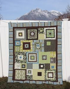 Blue, brown and green improv quilt