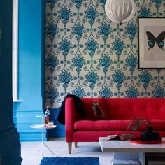 *that* shade of blue and that pinky-red couch