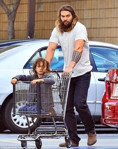 Precious cargo: Jason Momoa picked up some groceries at Whole Foods in Angeles on Monday