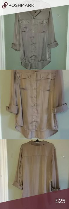 *beautiful dressy shirt* Has a slight high low effect. Beautiful shiny tan color! 100% polyester. Fred David Tops Button Down Shirts