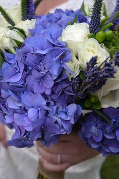 Bouquet: Creme roses, lavender, greenery and purple hydrangeas.