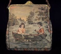 1900s tapestry purse with scene of children in a boat.