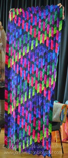 quilt ... pattern here ... http://www.janhassard.co.uk/dazllingdiamonds.html