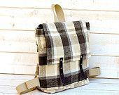 http://www.etsy.com/treasury/ODM2Nzk3NnwyNzIzNDg1MjAy/modern-inspirationWaterproof Backpack in charcoal titanium Whitecap Gray plaid upholstery