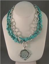 "Susan Shaw Turquoise and Silver Coin Necklace          Item Number:  SSTSCN  Turquoise beads layered with silver chain link coin pendant necklace create a layered look that is so easy to wear and compliments so many outfits.  Necklace is about 18""    Your Price	$65.00"