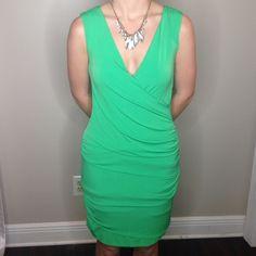"Ruched green sleeveless dress Sleeveless v-neck dress. Hem falls approx 2"" above knee on a 5'6"" model. Dresses"