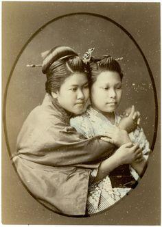 Girls embracing each other. Raimund von Stillfried. Meiji Period. Japan.