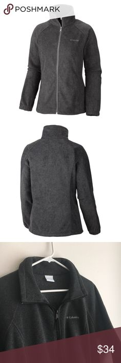 Gray Columbia Jacket Columbia jackets are a classic fall/winter closet staple. This one is a charcoal gray fleece zip-up jacket in size XL. This jacket features zippered pockets, adjustable waist drawstring, and cozy insulating fleece fabric (100% polyester). It is in great condition from a smoke free home.  The stock photos are a similar product for sale from Columbia, but are not identical to the product for sale. The last 5 photos are photos of the actual jacket.  I offer same day…