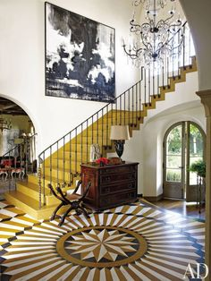 The entrance hall of El Sueño, entrepreneur Michael Rosenfeld's Los Angeles house, designed by architect Kevin A. Clark and decorated by Madeline Stuart. From Architectural Digest. Design Entrée, Floor Design, Interior Design, Modern Interior, Design Trends, Interior Ideas, Design Elements, Architectural Digest, Spanish Colonial Homes