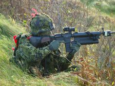 Danish PVT with a C7 rifle and granade launcher.