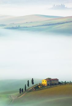 Val d'Orcia among the morning mist - Tuscany