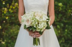 Classic southern bridal bouquet by @flwrgirlcaprice: magnolia leaves, hydrangea, blush roses, ivory roses