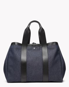Transitioning seamlessly from weekend getaway to daily carryall, this denim tote was designed with the traveler in mind. Soft handle straps are molded to fit the palm of the hand, and are thick enough to remain comfortable no matter the weight of the contents. With minimal stitching and silver hardware, this tote is an instant classic.