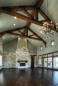 Dining room - family room - living room in one. Limestone fireplace - Douglas fir beams. Built by Olson Defendorf Custom Homes, Austin, Texas.