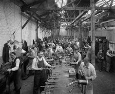 September 1918 Belgian refugees manufacture artillery shells at the Belgian Munition Works in London.