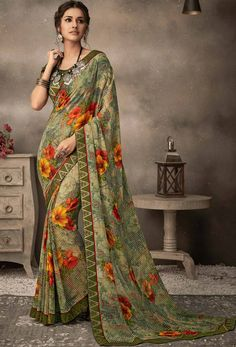 Green Color Georgette Flower Printed And Fancy Lace Border Daily Wear Saree Product Details : Unlock the secret of ultimate comfort wearing this green color daily wear saree. Crafted of georgette fabric, this saree comes with unstitched raw silk blo Georgette Sarees, Silk Sarees, Embroidery Saree, Printed Sarees, Printed Silk, Casual Saree, Designer Sarees Online, Traditional Sarees, Half Saree