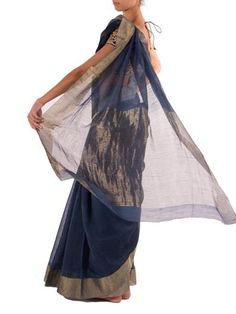 Raw mango's silk cotton saree is the key to effortless dressing. This crisp petrol blue saree has a comfortable touch with beautiful gold thread border on side and silver on the other. Pair yours with simple sandals and gold jewelry. This item does not come with a blouse piece. - See more at: http://www.byelora.com/Shop/Raw-Mango/Rangeen-saree-in-blue#sthash.V0jEVocB.dpuf