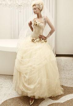 Strapless long white wedding dress with full tulle skirt, ballerina inspired design, & flower accents from Atelier Aimee.