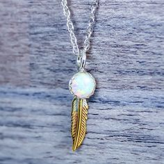 Mermaid Opal and Feather Necklace. Made with Sterling Silver, Brass and synthetic opal. Bohemian Festival Mermaid Gypsy Jewels by Indie and Harper Bohemian Jewellery, Gypsy Jewelry, Opal Jewelry, Indie And Harper, Feather Necklaces, Bohemian Gypsy, Opal Rings, Jewelery, Mermaid