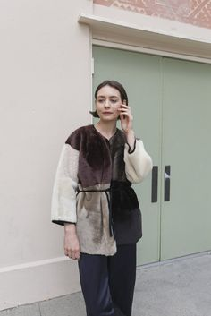 Milena Silvano Diamond Kimono Handmade patchwork sheepskin kimono coat with cropped, wide sleeves and suede self-tie and suede contrast piping. - Handmade in England - Chantal is wearing size S - Ques