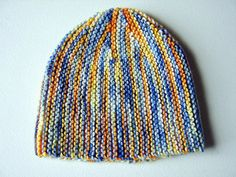 """Short-Rows Beanie on Ravelry: """"This little beanie is knit flat and sideways. It's all garter stitch and an easy way to try out short rows. Very satisfying knitting as you're always decreasing and there are lots of milestones to make you feel like you're making progress."""""""