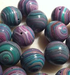 16 Hand wrapped round beads. Starting at $5 on Tophatter.com!