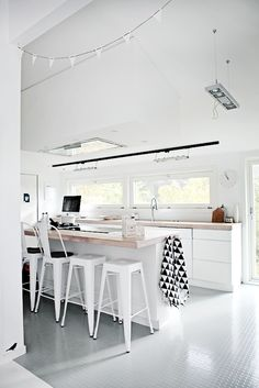 White kitchen with light wood bench