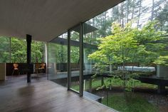 Japan's Modernist Spread House is an Elegant, Low-Impact Home with a Tree Growing Through It