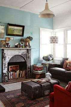 books in the fireplace and a trunk as coffee table!