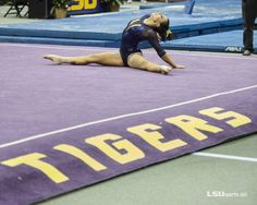 BATON ROUGE - LSU sophomore gymnasts Rheagan Courville and Lloimincia Hall were named SEC Gymnast of the Week and SEC Specialist of the Week, respectively, by the Lsu Gymnastics, Female Superheroes And Villains, Female Gymnast, Lsu Tigers, Leotards, Basketball Court, Fitness, Live, Purple