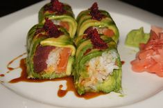 Phillip Roll: salmon and spicy tuna with sushi rice in the middle separating the two fishes. The whole thing was wrapped in slices of avocado, no nori on this one and topped with tobiko.