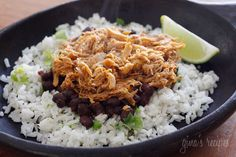 Skinnytaste Sweet Barbacoa Pork over Cilantro Lime Rice and Black Beans   Sweet and spicy slow cooked pork sweetened with brown sugar, cola, chipotle chilies, green chilies, cumin and spices. Delicious over cilantro lime rice and black beans.