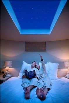 Big skylight above the bed for thunderstorms and star-gazing ... with a remote-controlled black-out blinds. Love this idea