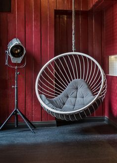 powder coated white steel wire bubble chair designed by ben rousseau with grey water resistant cushion